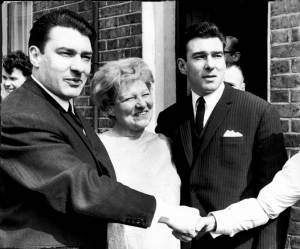 The Kray Twins with their mother outside their Bethnal Green home in East London in 1965. (L-R) Ronnie Kray, Violet Kray and Reggie Kray . REXSCANPIX. Twin brothers Ronald